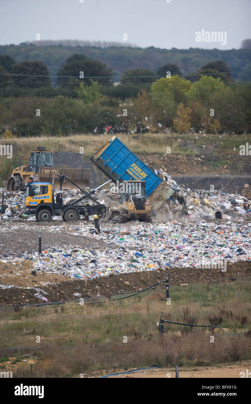 Lorry tipping plastic into a landfill site - Stock Image