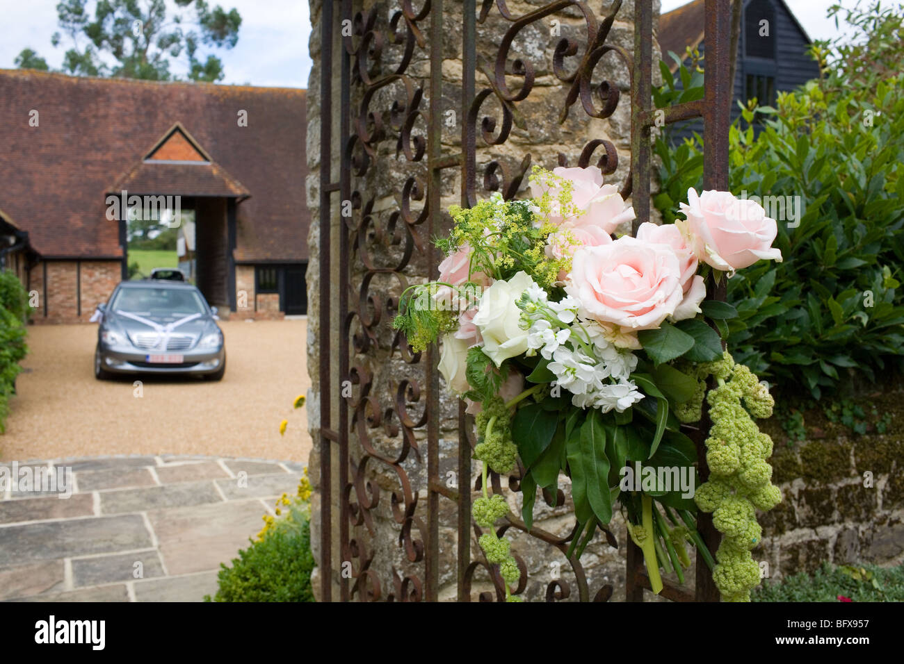 Roses on the gate of a country house hosting a wedding Stock Photo