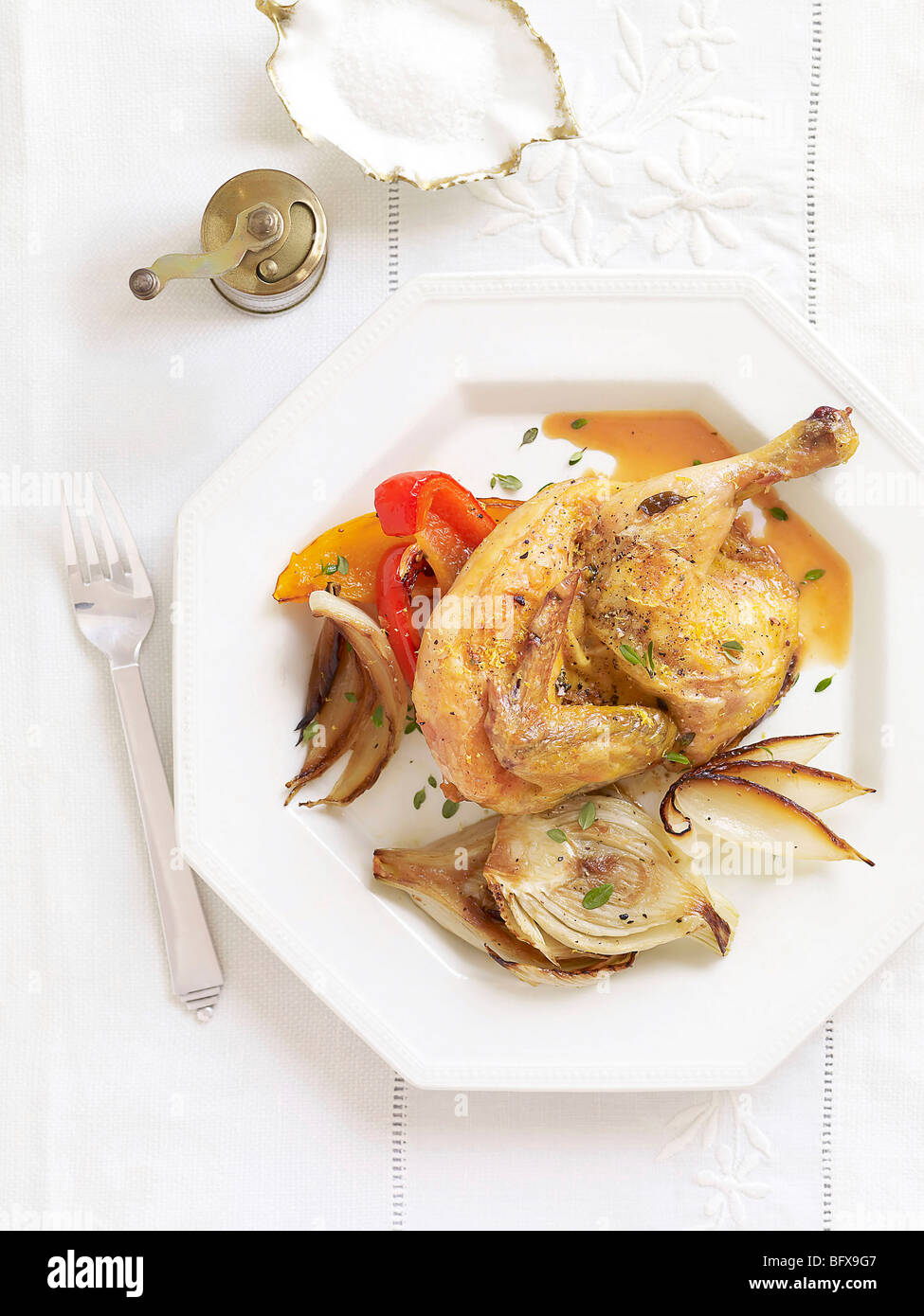 roasted cornish hens with fennel and peppers - Stock Image