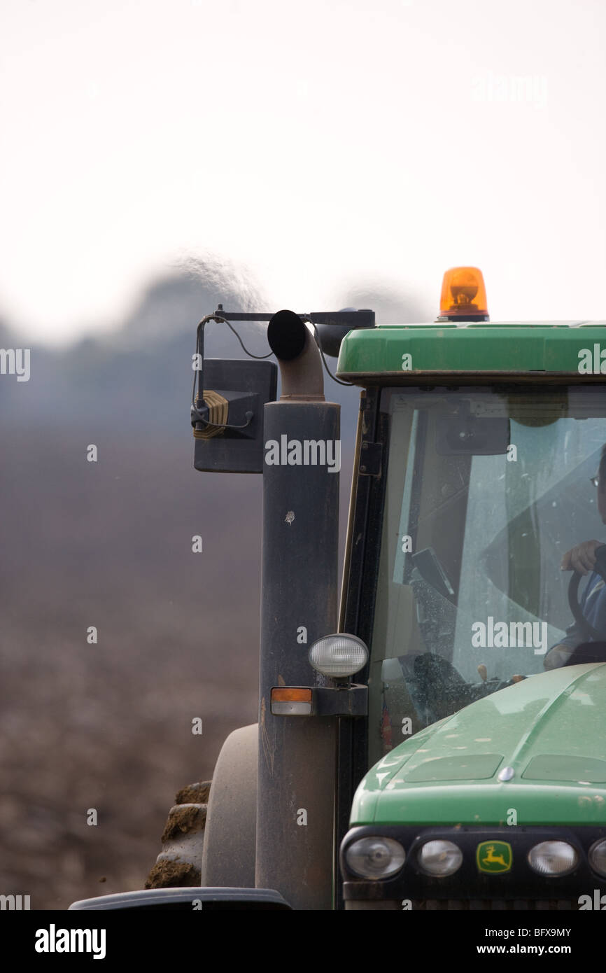 Emissions coming from a Farm Tractor - Stock Image