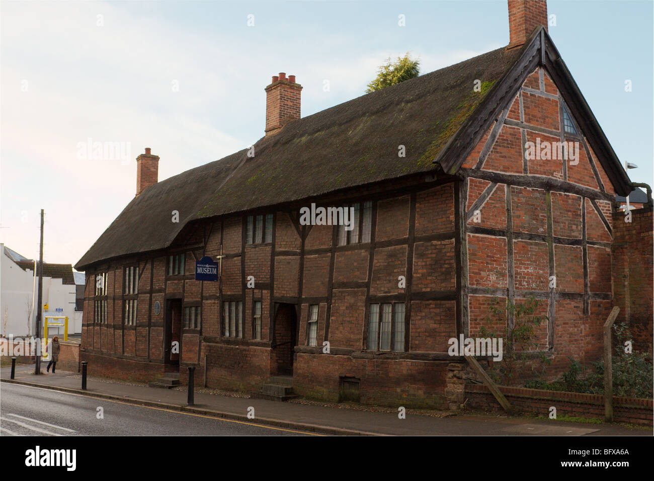 A row of wood framed knitter's cottages. - Stock Image