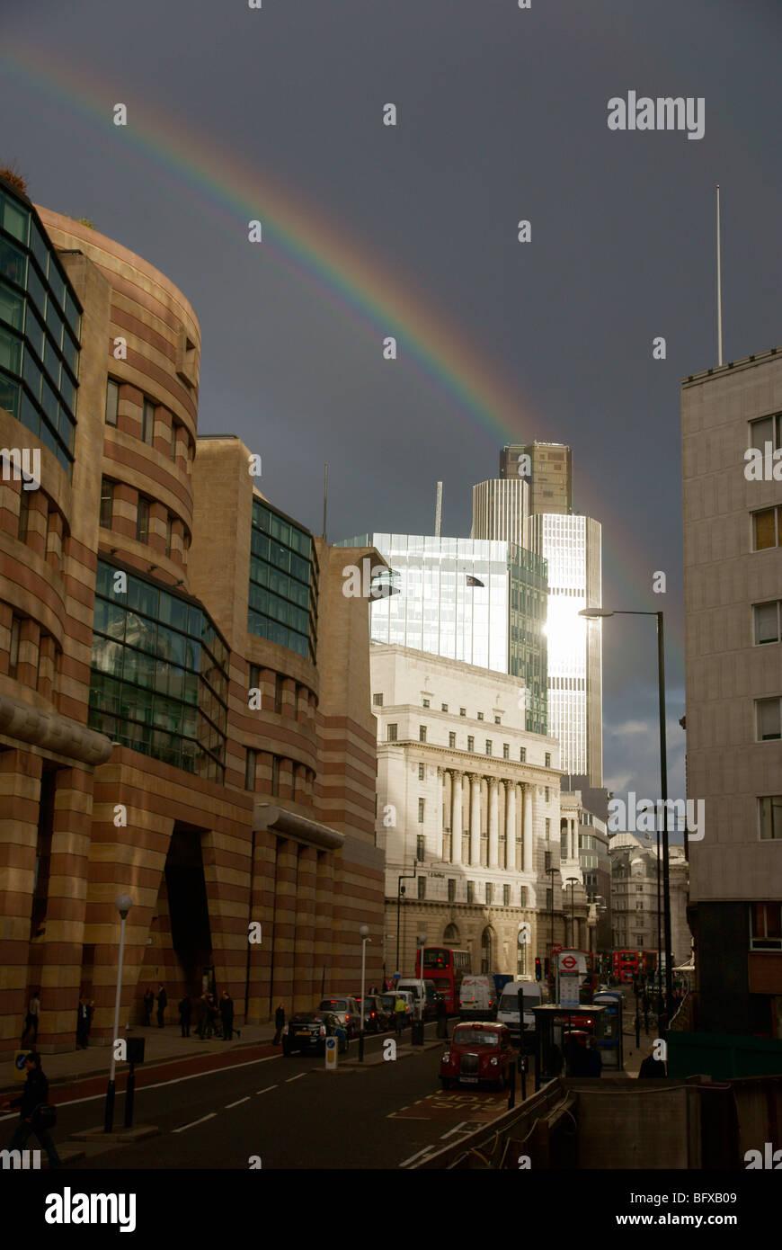 Rainbow against dark sky over london city skyline - Stock Image