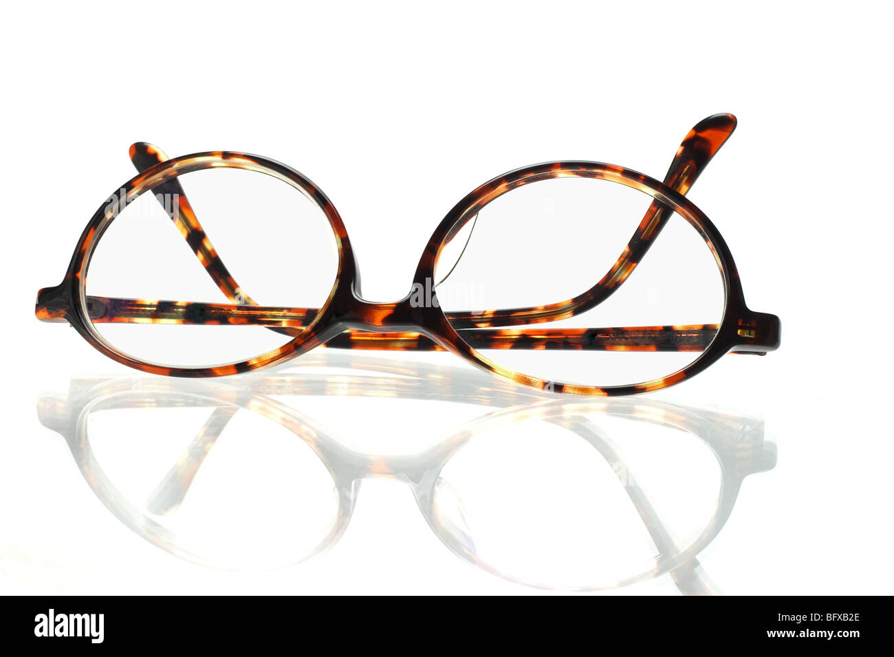 Old fashion plastic frame eyeglasses on white background - Stock Image