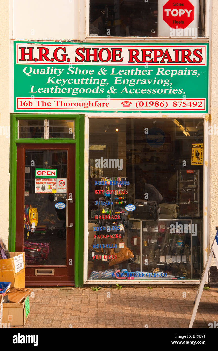 H.R.G. shoe repairs shop store in the high street in Halesworth,Suffolk,Uk - Stock Image