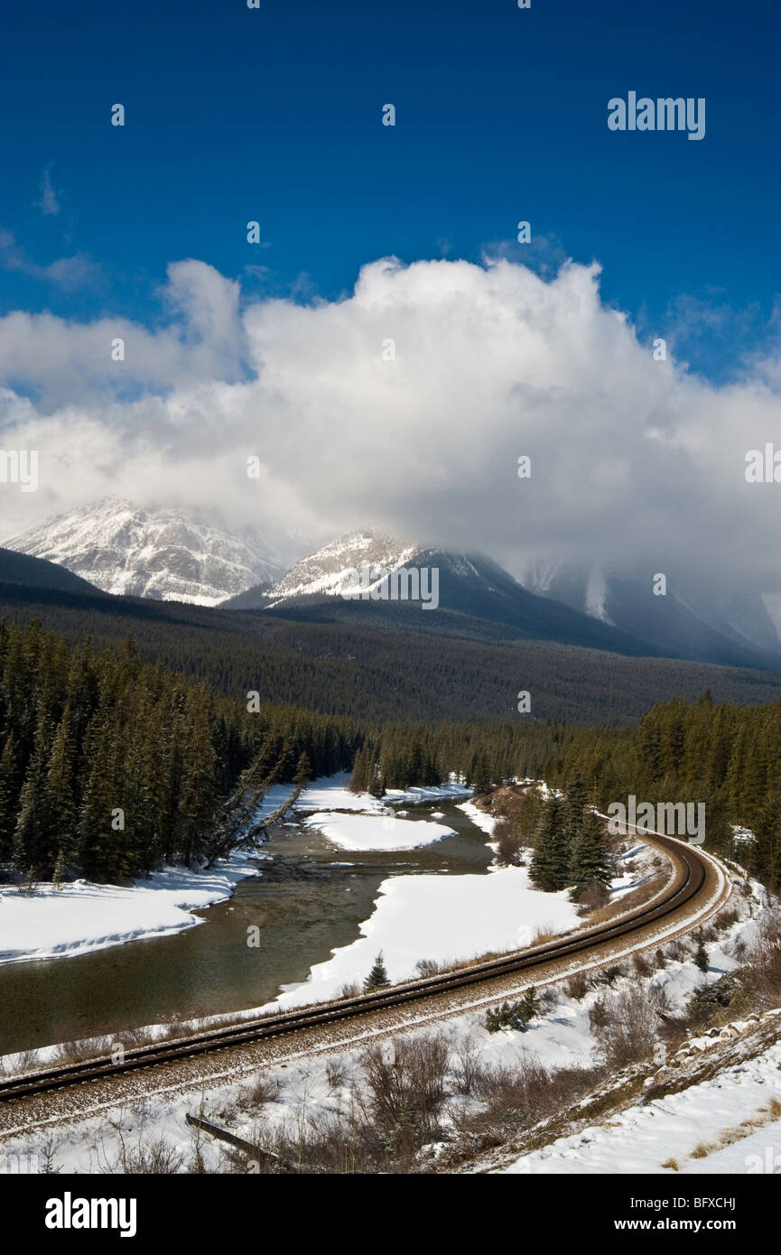 Bow River with via rail line at Morant's curve, Banff National Park, Alberta, Canada - Stock Image