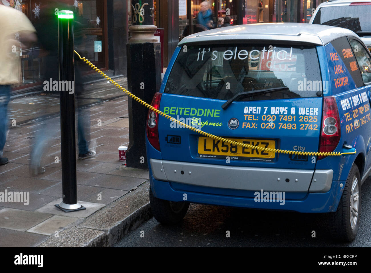 An electric car parked at a charging point in Barclay Square London - Stock Image