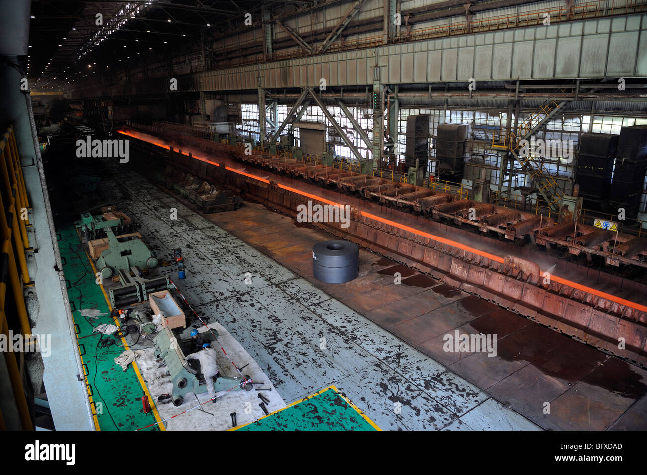 Molten hot plate steel being rolled at Shanghai Baosteel factory. 20-Oct-2009 - Stock Image