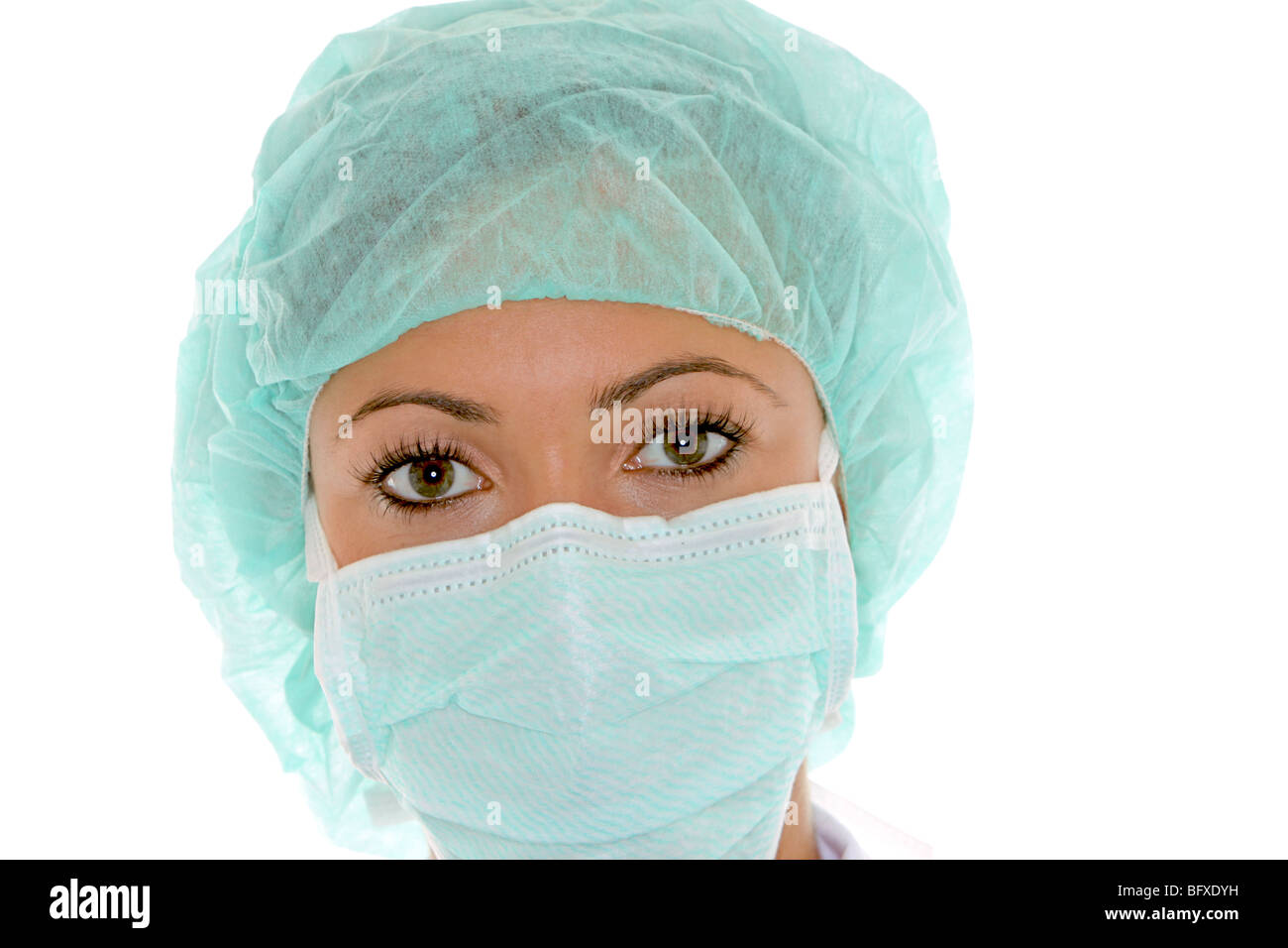 Ärztin mit Mundschutz und Schutzhaube, female doctor with surgical mask Stock Photo