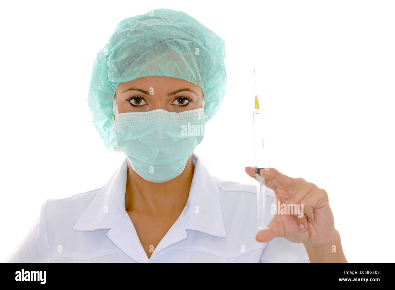 Aerztin mit Mundschutz und Spritze, female doctor with surgical mask and injection Stock Photo