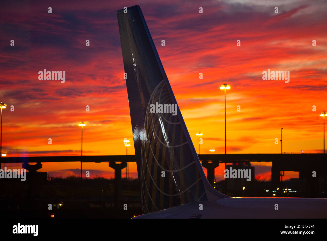 Sunset behind a Continental Airlines Airplane at Newark Liberty International Airport - Stock Image