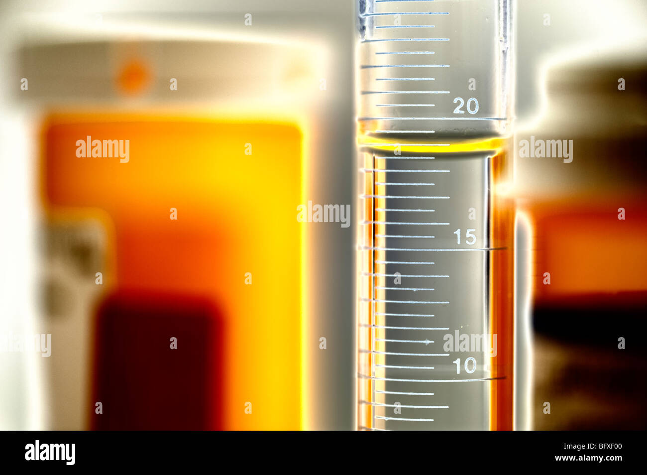 assortment of lab bottles and beakers - Stock Image