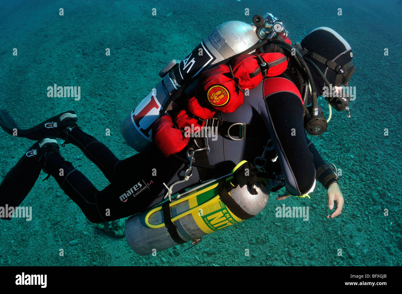 Technical scuba diver with multiple cylinders in shallow water Ras Abu Gallum, , 'Red Sea' - Stock Image