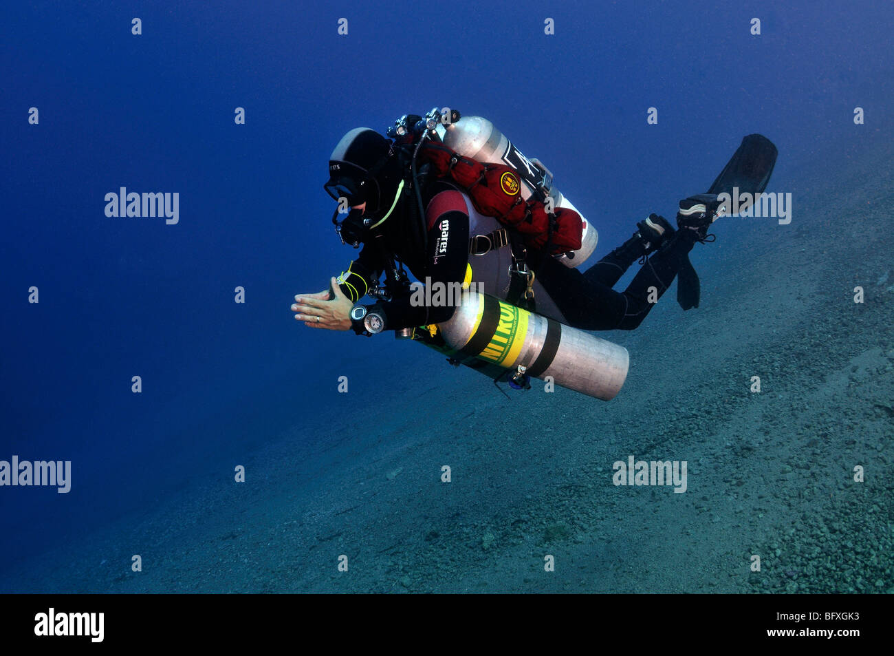 Technical scuba diver with multiple cylinders in shallow water Ras Abu Gallum, 'Red Sea' - Stock Image