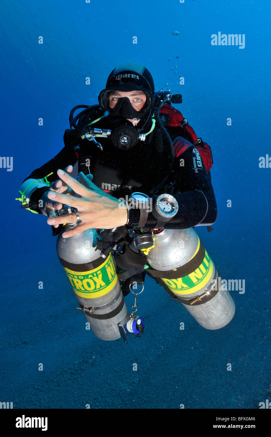 Technical scuba diver diving underwater with multiple cylinders Ras Abu Gallum, , 'Red Sea' - Stock Image