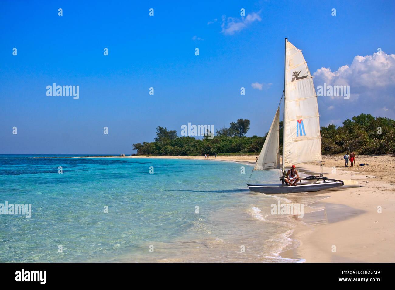 Cuban sailboat with national Cuban flag on sail - Stock Image