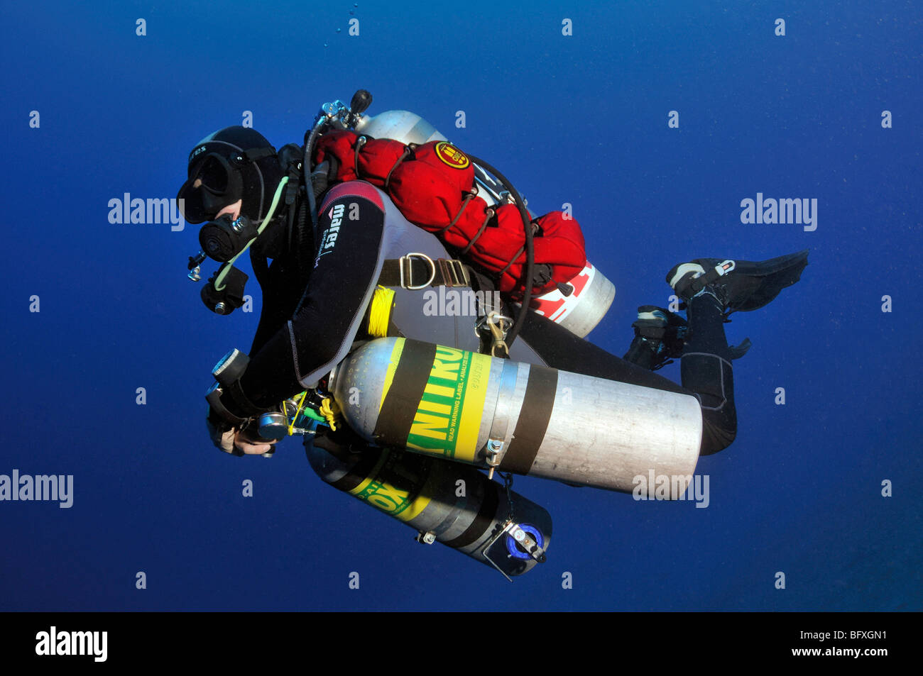 Technical scuba diver diving underwater with multiple cylinders Ras Abu Gallum, 'Red Sea' - Stock Image