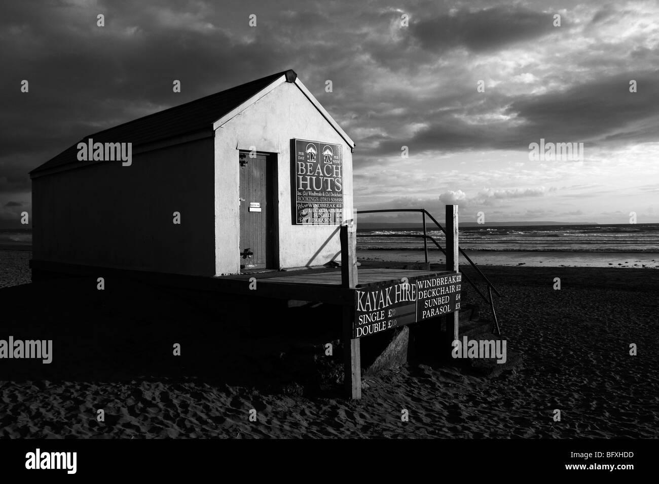 Interesting Black & White Beach Hut Image - Stock Image