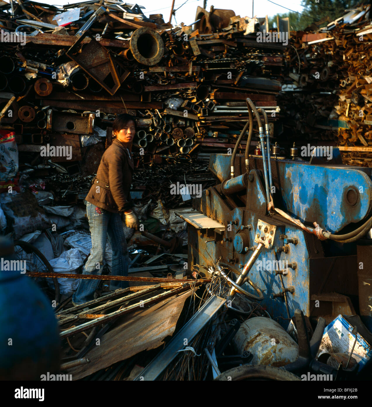 Chinese woman works at scrap metal yard in Beijing, China. 2009 - Stock Image