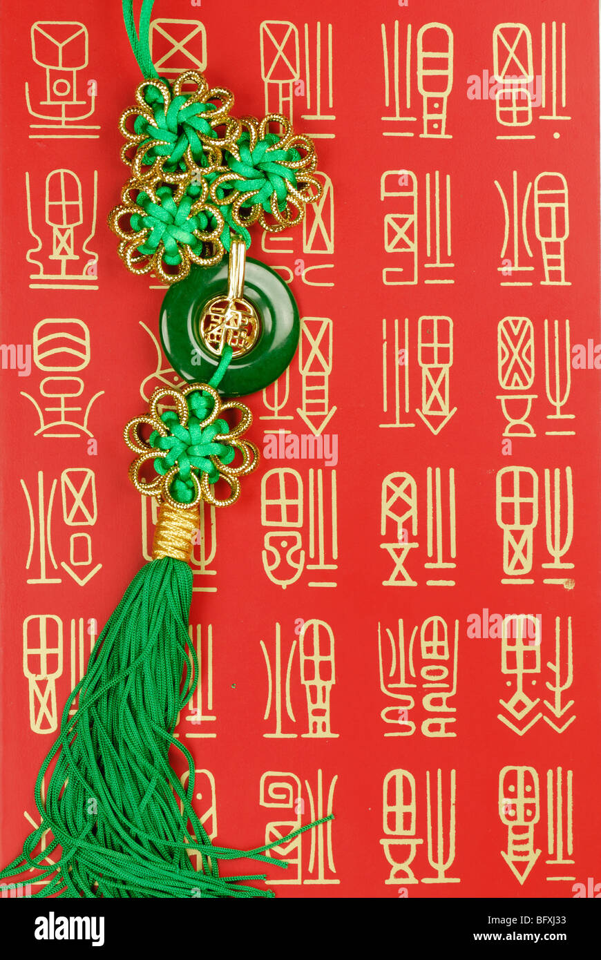 Chinese traditional knot on auspicious background,closeup. - Stock Image