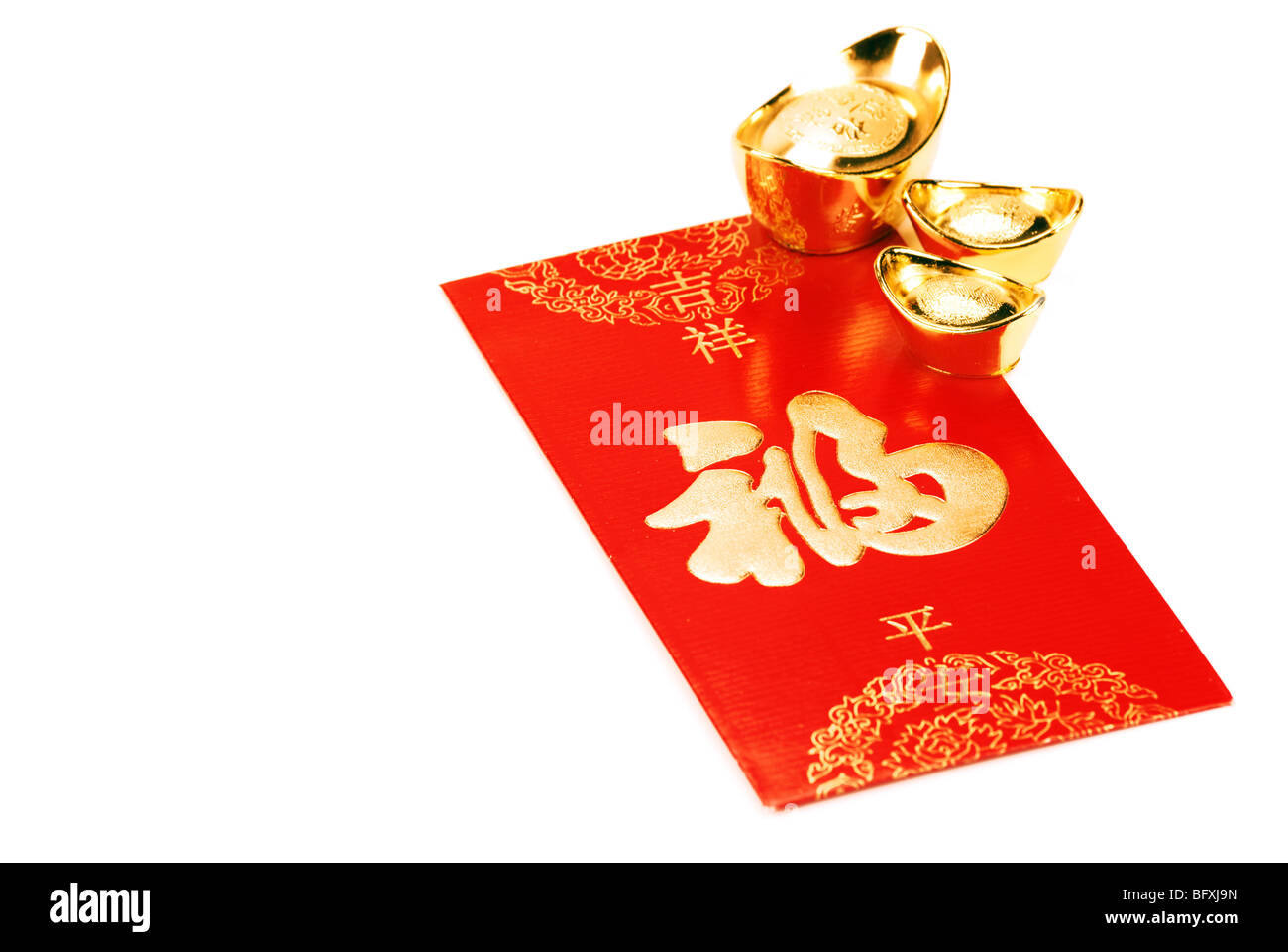 Red envelope and gold ingot,isolated on white. - Stock Image