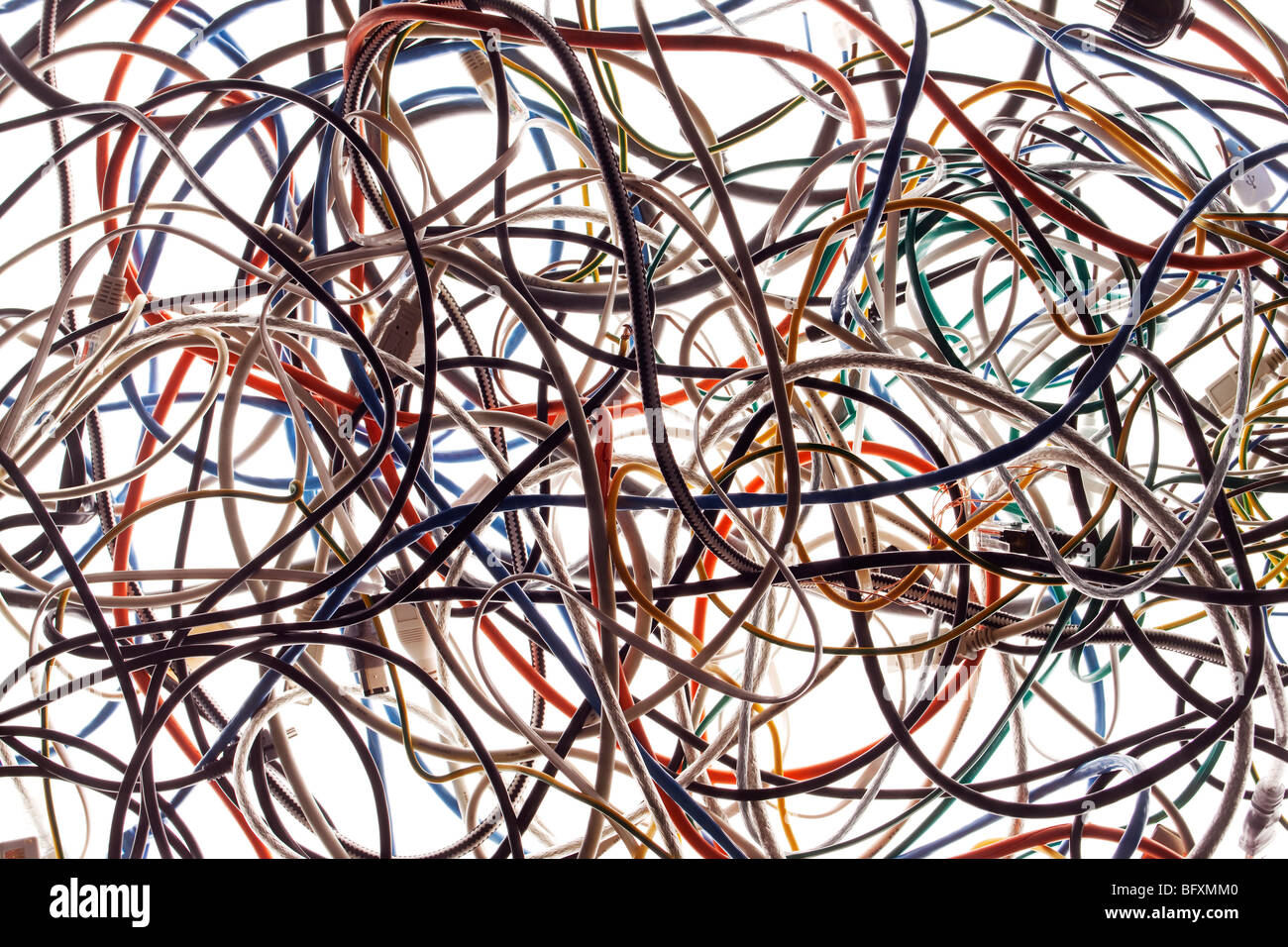 A tangle of colored wires on the ground - Stock Image