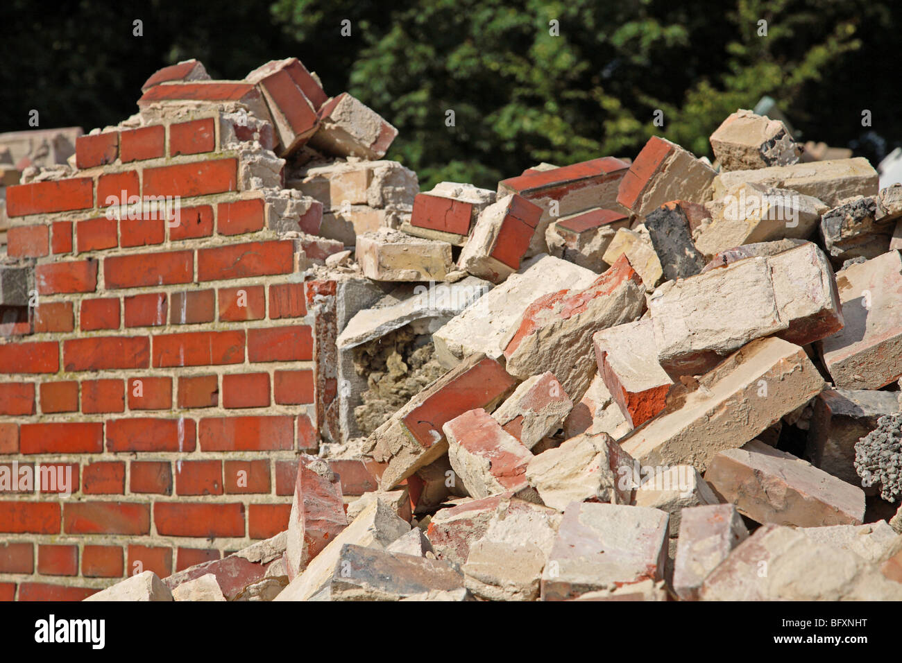 Demolition of a red brick wall. - Stock Image