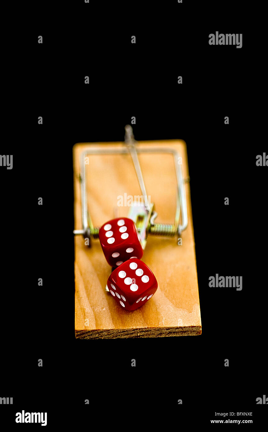 Dice on mousetrap - Stock Image