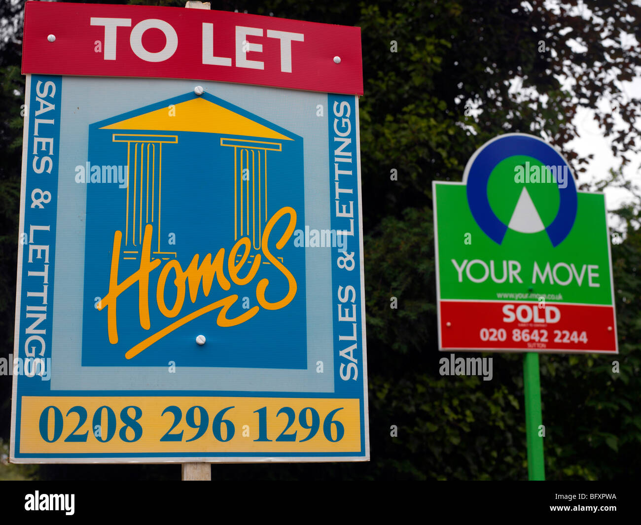 Signboards - Home For Sale & Flat Sold in England - Stock Image