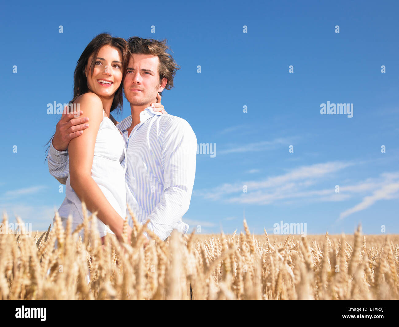young couple in wheat field Stock Photo