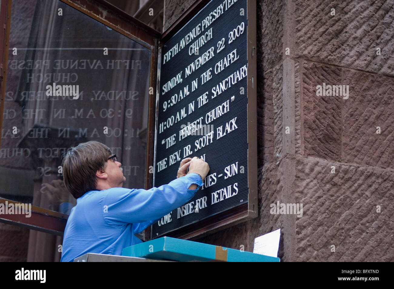 Services signboard is updated at the Fifth Avenue Presbyterian Church in New York - Stock Image