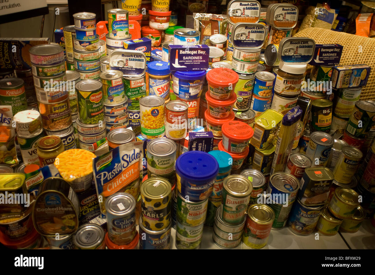Non-perishable food collected for City Harvest by the store CB2 in the Soho neighborhood of New York - Stock Image