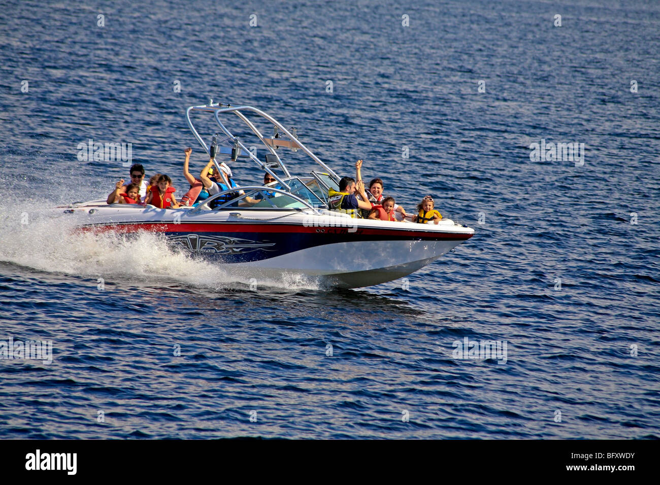 Family boating fun on a Lake in Cottage Country in the Summer on Lake Muskoka in Gravenhurst,Ontario;Canada - Stock Image