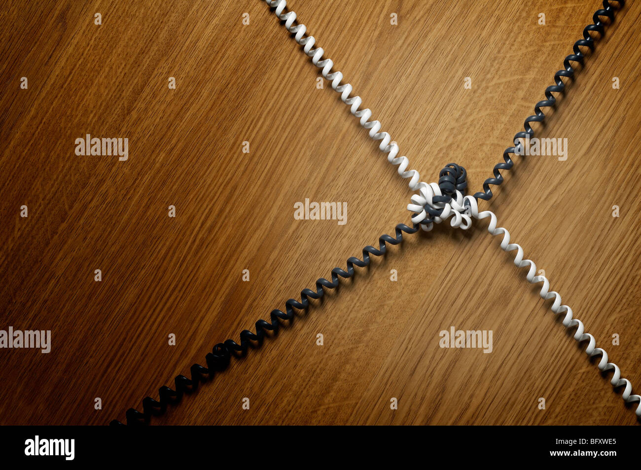 Twisted and knotted telephone cables - Stock Image
