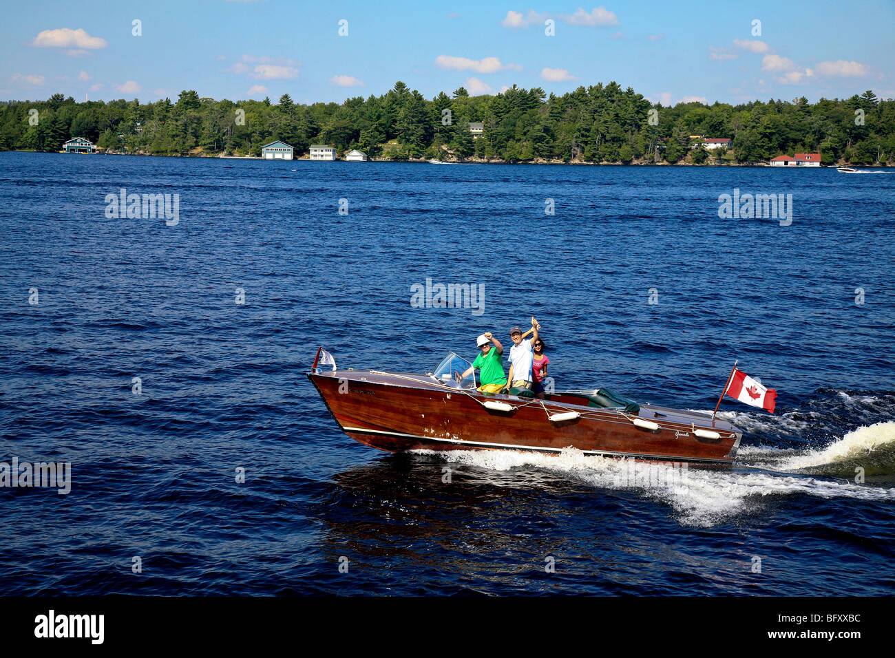 Family boating fun on lake in Cottage Country in the Summer on Lake Muskoka in Gravenhurst,Ontario;Canada - Stock Image