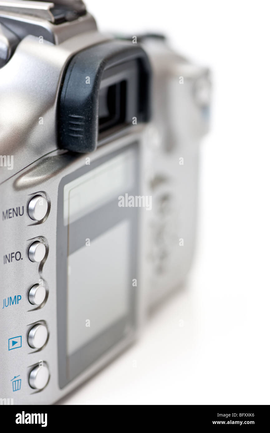 The back of a digital SLR camera, with focus on the buttons and LCD display, isolated on white. - Stock Image