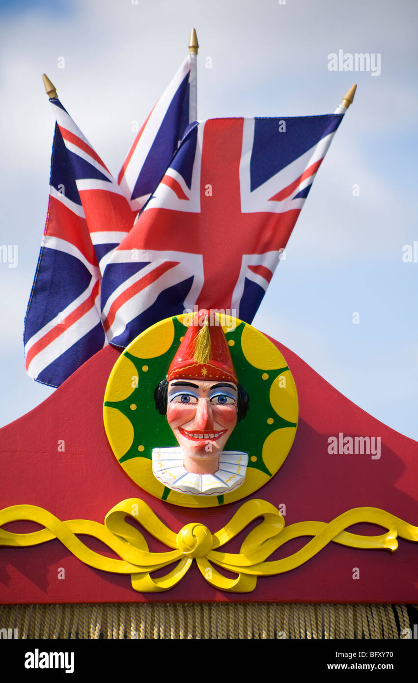 Mr Punch figurine with Union flags behind. Sussex, England. - Stock Image