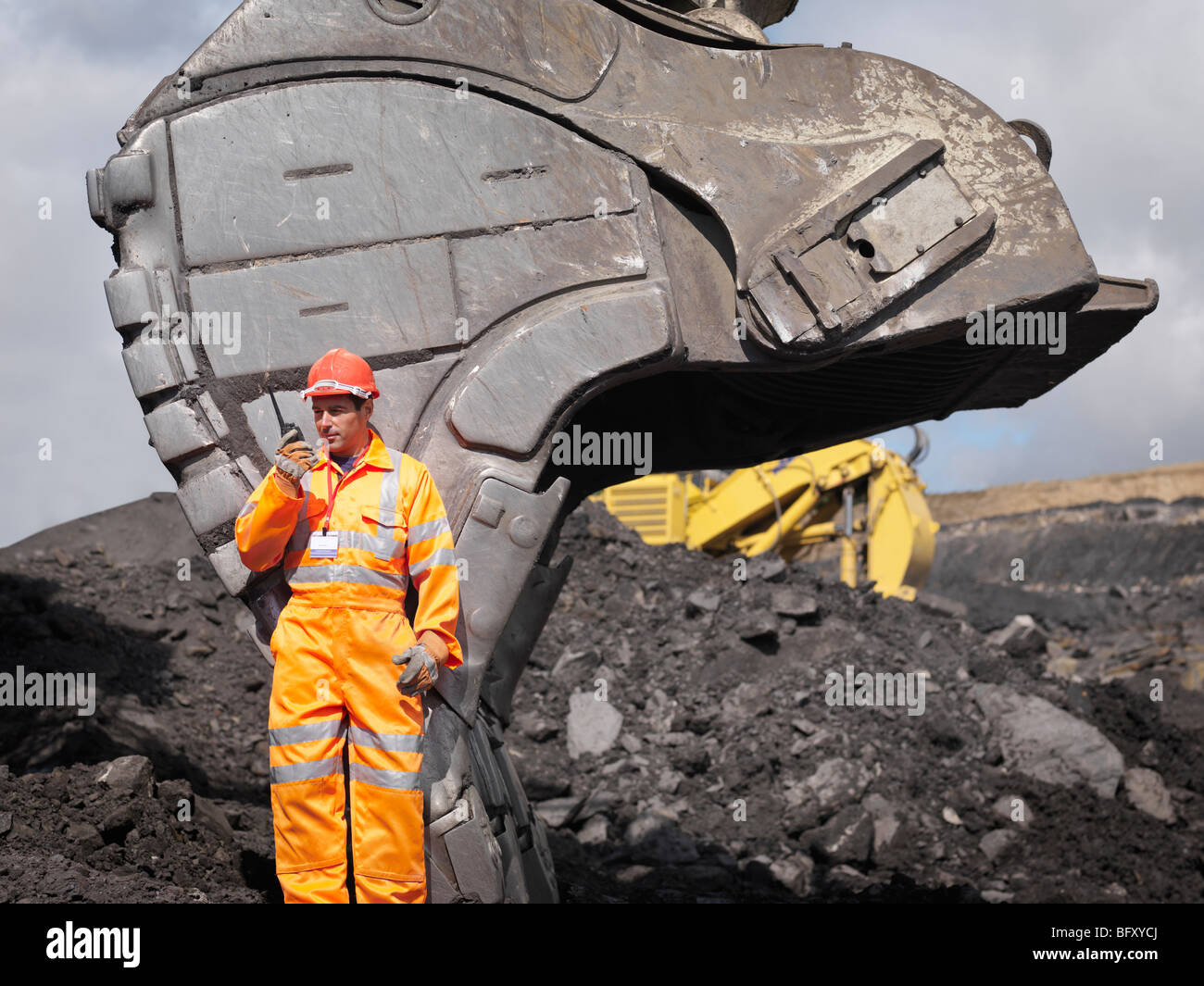 Coal Miner With Walkie Talkie - Stock Image