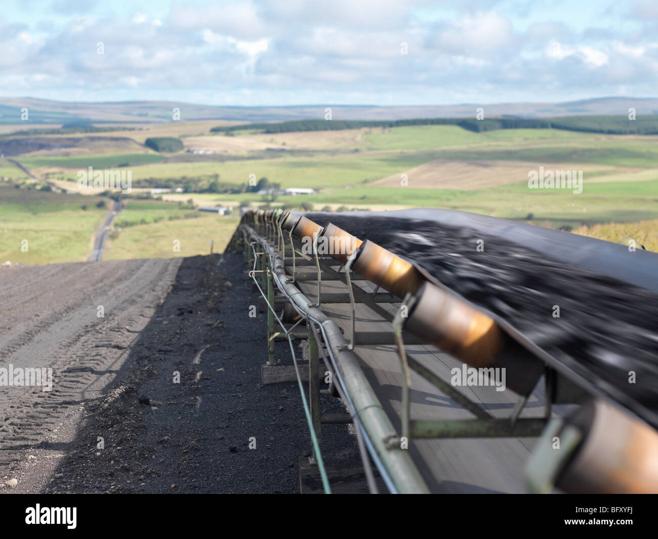 Mined Coal Traveling on Conveyor Belt - Stock Image
