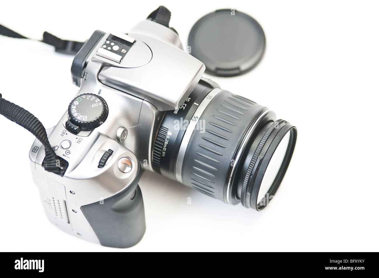 Closeup of the top of an DIgital SLR camera, looking down from above, isolated on white. - Stock Image