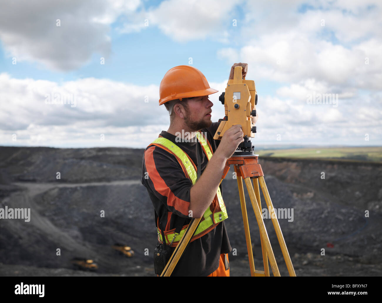 Coal Miner With Surveying Equipment - Stock Image