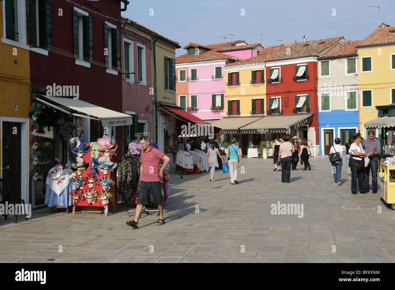 Venice, Burano, busy street with mask shop - Stock Image