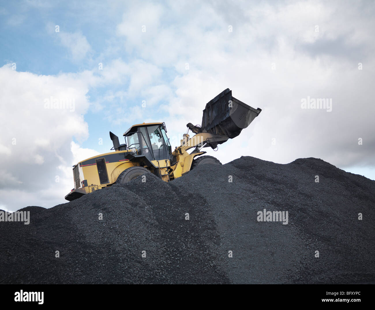 Digger On Pile Of Coal In Mine - Stock Image