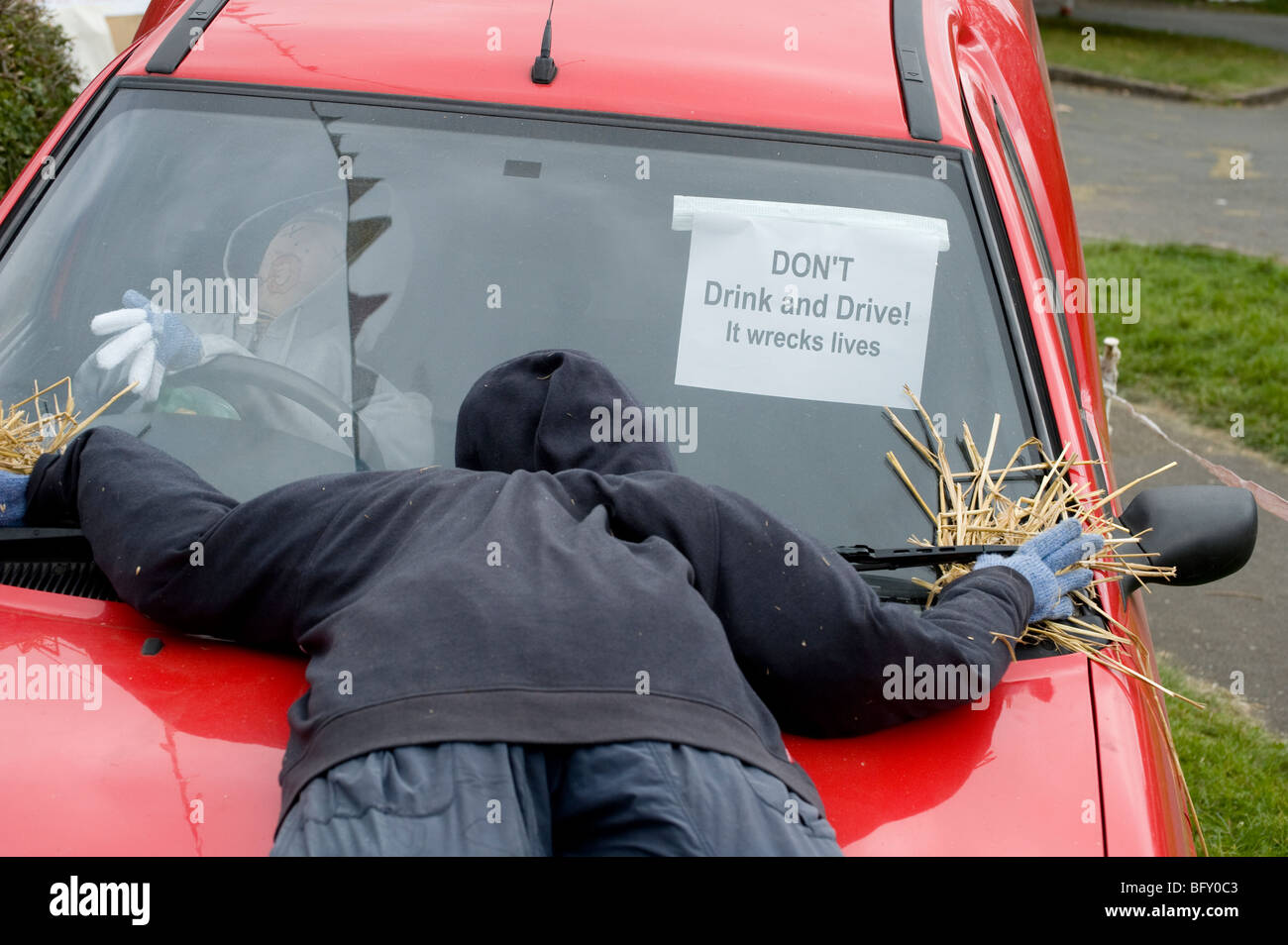 Scarecrows being used to illustrate the dangers of drinking and driving. - Stock Image