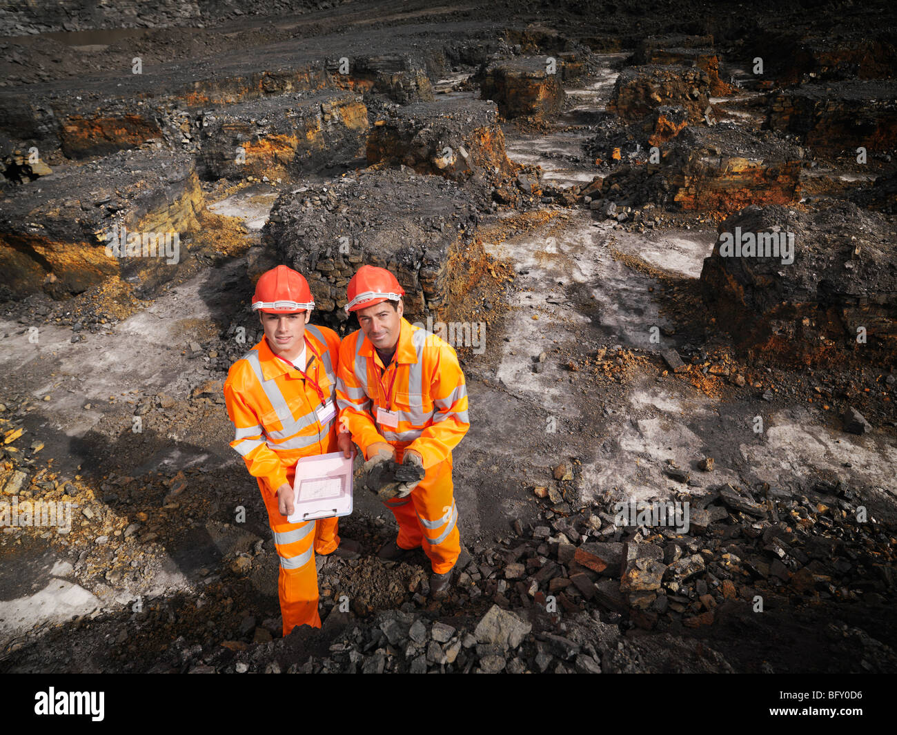 Workers With Clipboard In Coal Mine - Stock Image