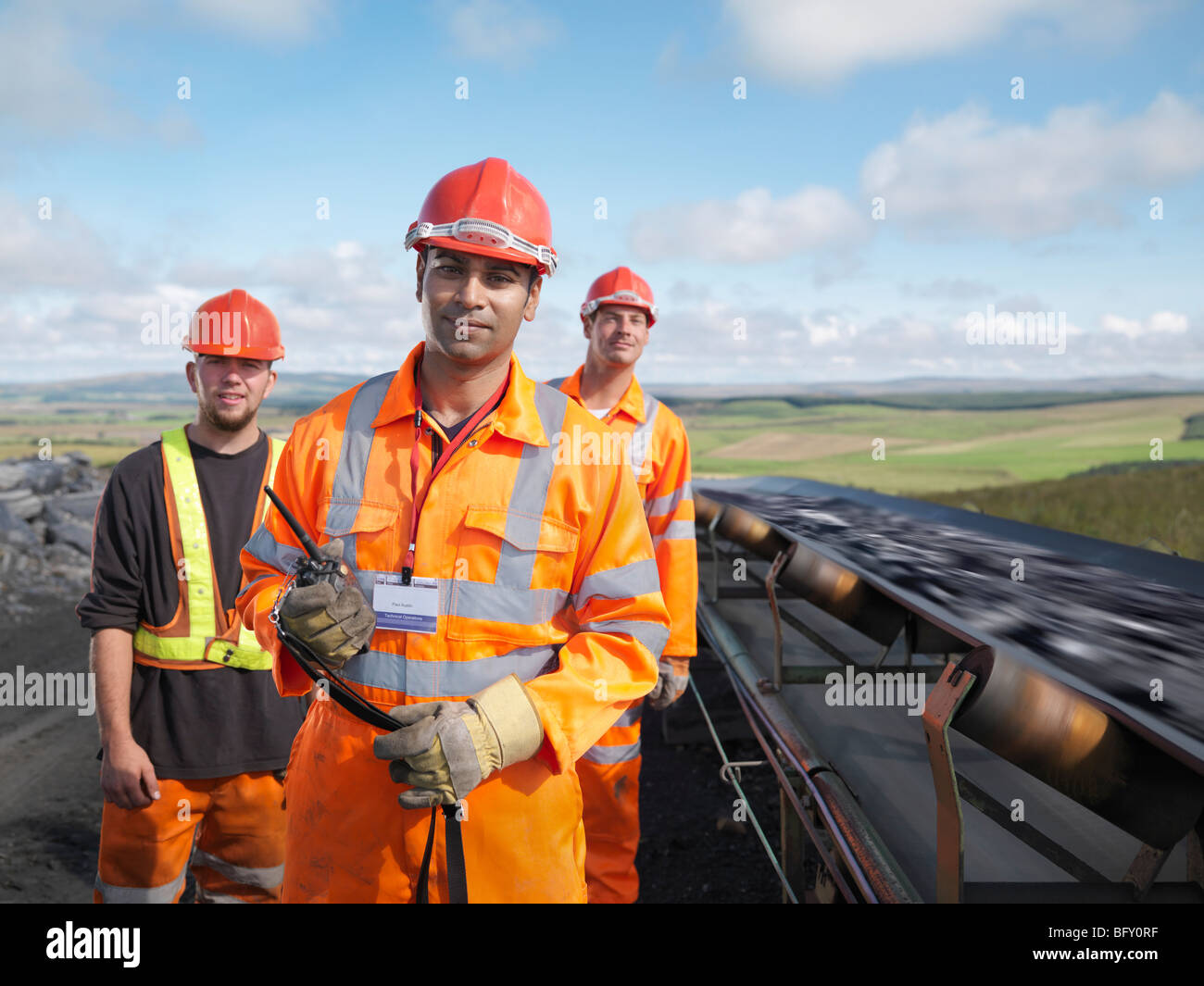 Coal Workers With Conveyor Belt - Stock Image