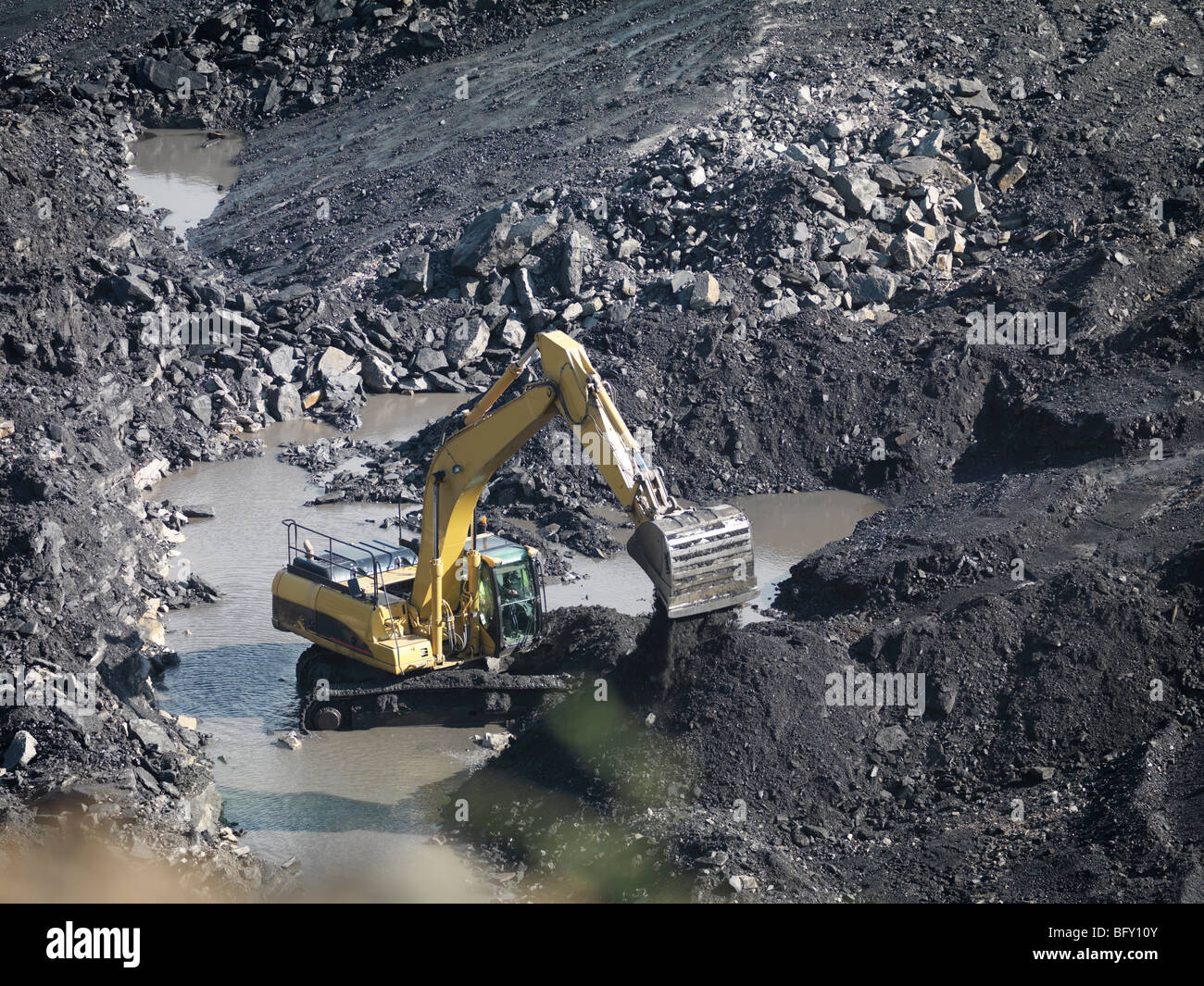 Coal Mine With Digger From Above Stock Photo