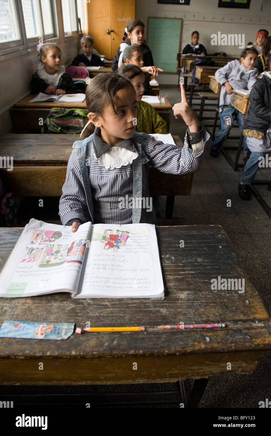 Palestinian children back in class at the UNRWA school which re opened  after the Israeli war