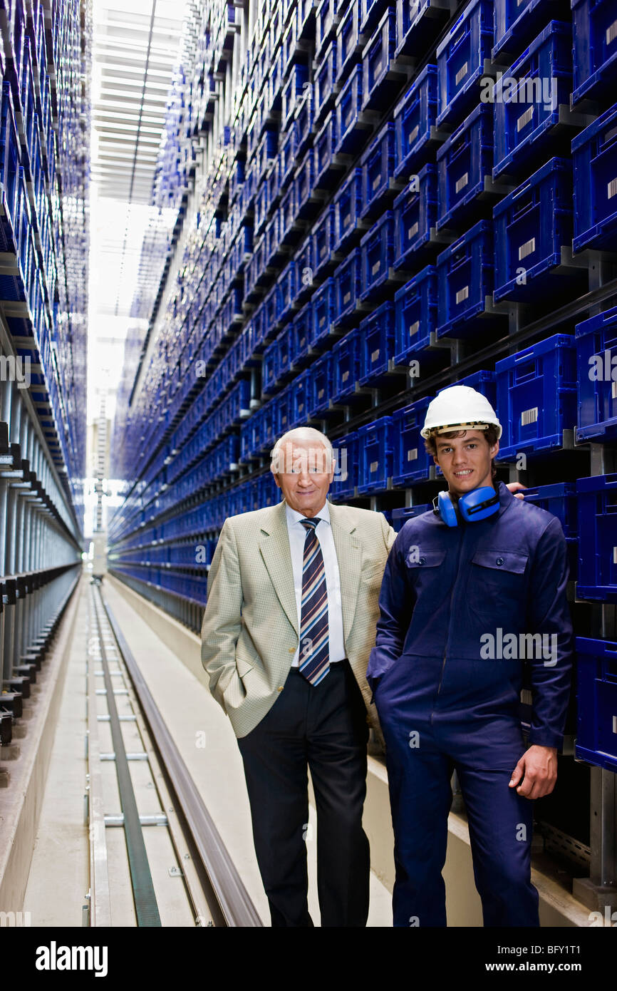 workman and boss in storage - Stock Image