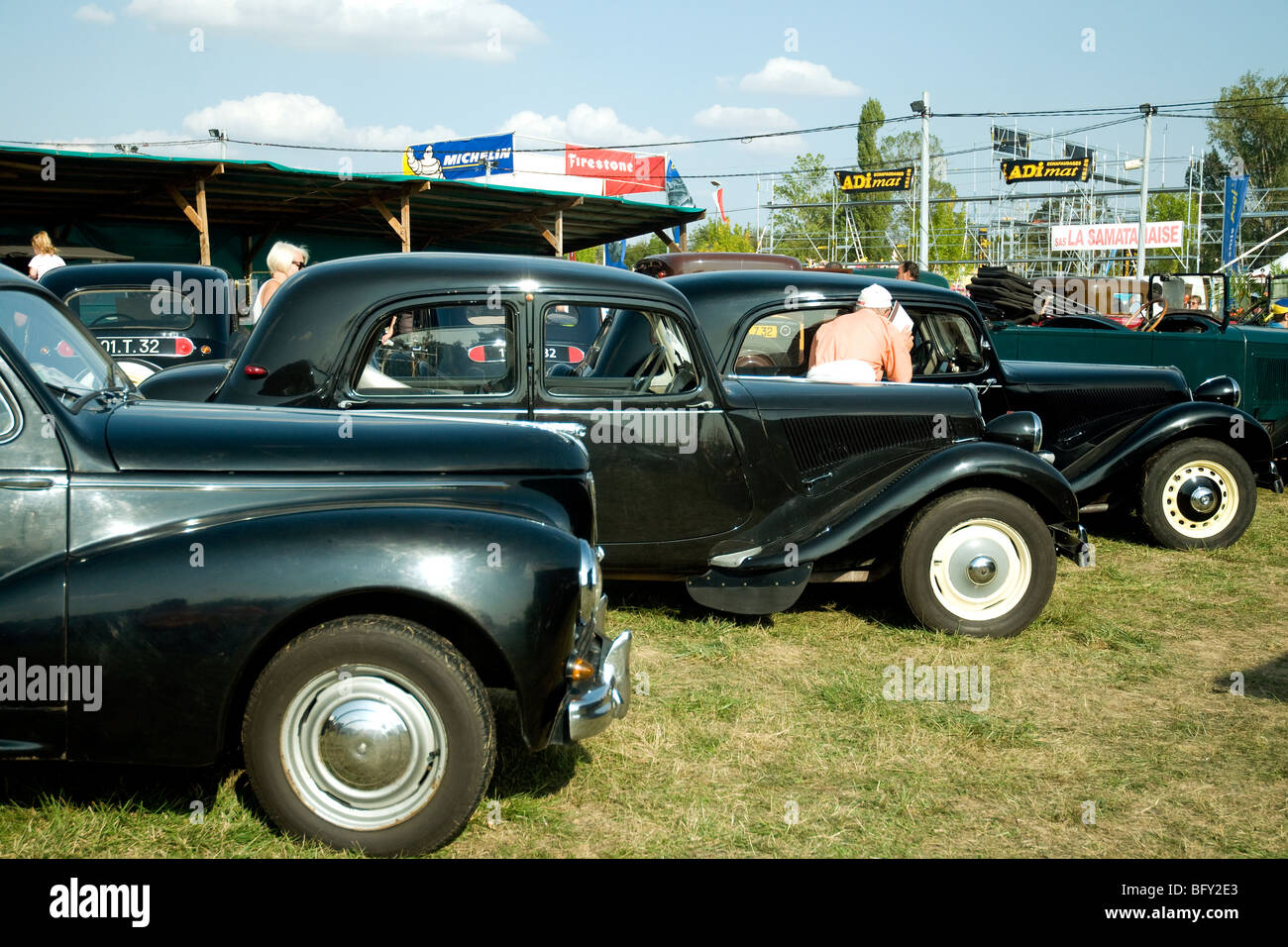 Vintage Citroen and Peugeot cars displayed at a Gascony agricultural and trade fair - Stock Image