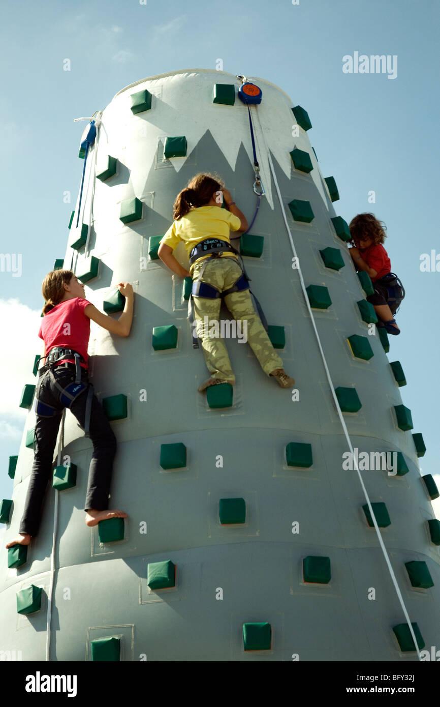 Bouncy climbing mountain 7-meters high tests kids skills at an agricultural fair in Auch, Gascony - Stock Image